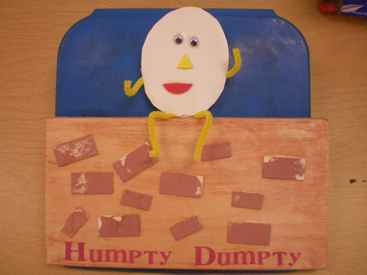 Humpty Dumpty: He was made out of a rectangular piece of wood which the students painted and added bricks to. They also added eyes, a nose and a mouth to the egg placed on top of the wall. Pipe cleaners were used for the arms and the legs.